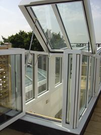 Skylight To Give Access To Roof Terrace For The Home