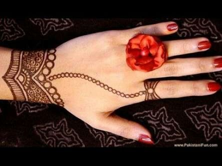 Flower Mehndi Designs On Back : Simple henna tatto part with ring and red flower tattoo
