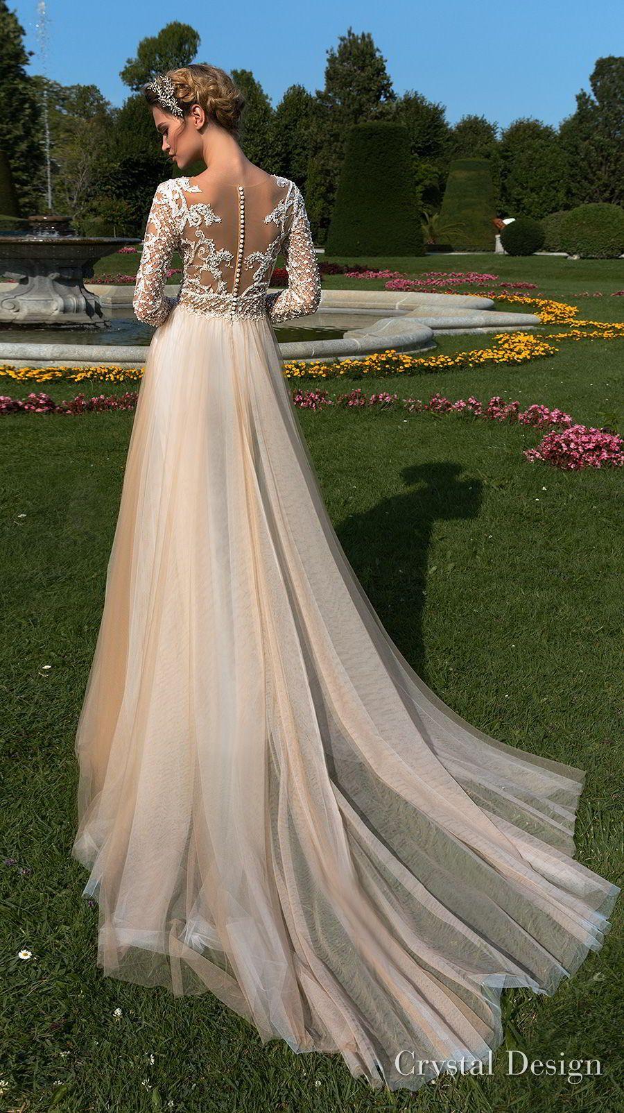 Champagne colored wedding dress  crystal design  long sleeves v neck heavily embellished bodice