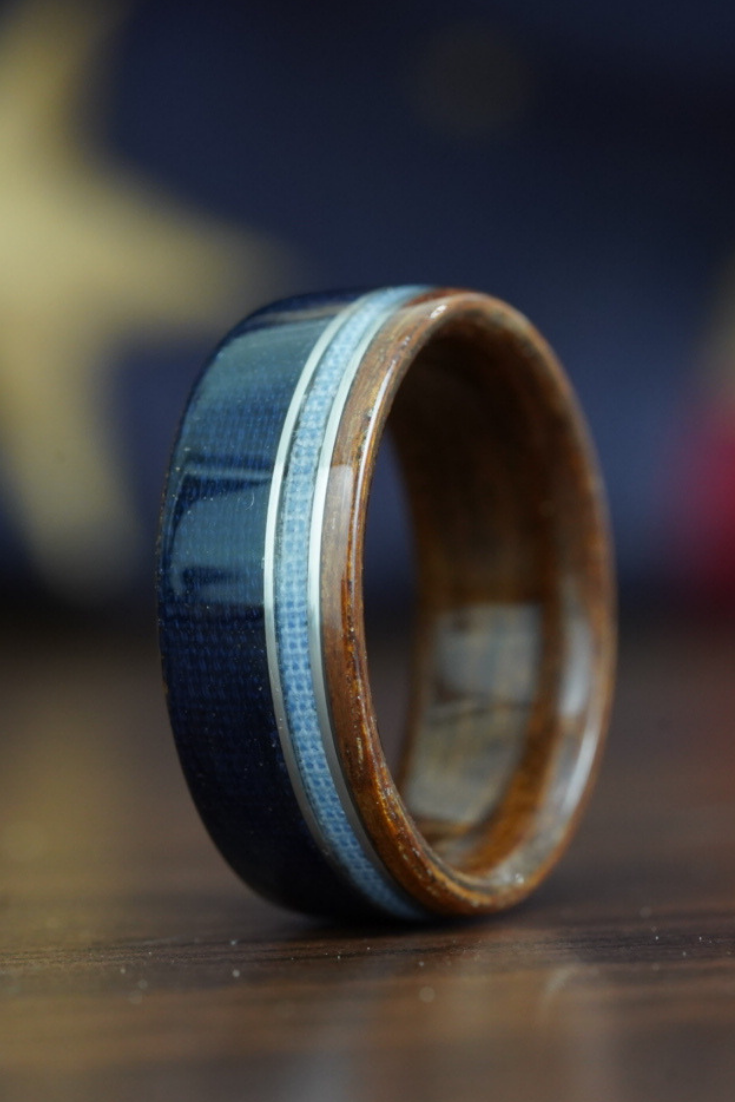 This rustic wedding ring is made of WWII Rifle stock with
