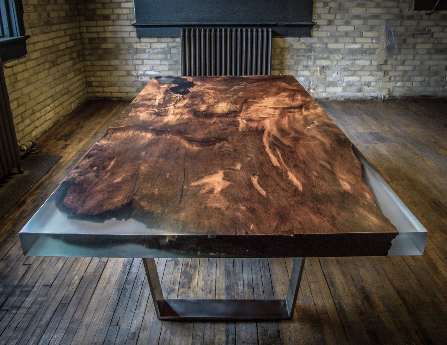Custom Redwood And Resin Dining Table With Metal Legs In Modern Industrial Warehouse Space