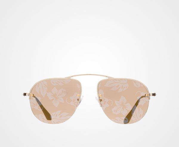 Exclusive mirrored lenses with hibiscus print mounted on top of the  ultra-light met.