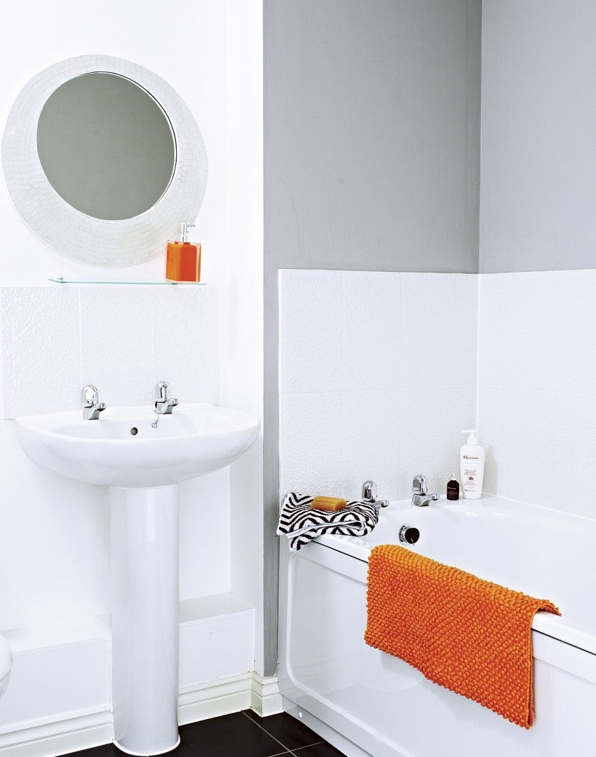 Add interest to a plain white bathroom in seconds by adding a few ...
