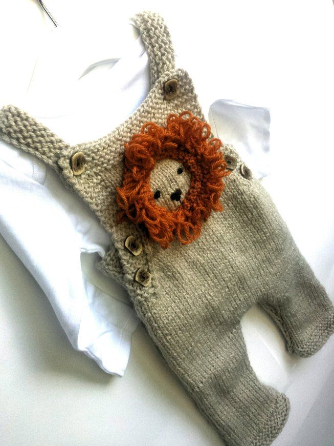 85a175712 Fun knitted dungaree with loopy lion motif