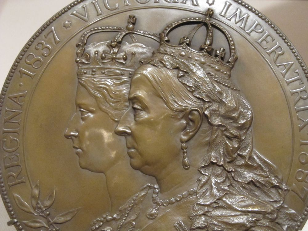 "1887 JUBILEE MEDAL OF QUEEN VICTORIA --Queen Victoria in her youth and at the time of her jubilee of 1887.... thus, a double portrait on a medal made in Austria, ca 1887.  Aprox: 2.5"" across. Note the liberal idea of the early crown. Many such items are not historically correct references, especially to jewels. The Metropolitan Museum of Art, NYC. Christian Orlov Photo 2015."