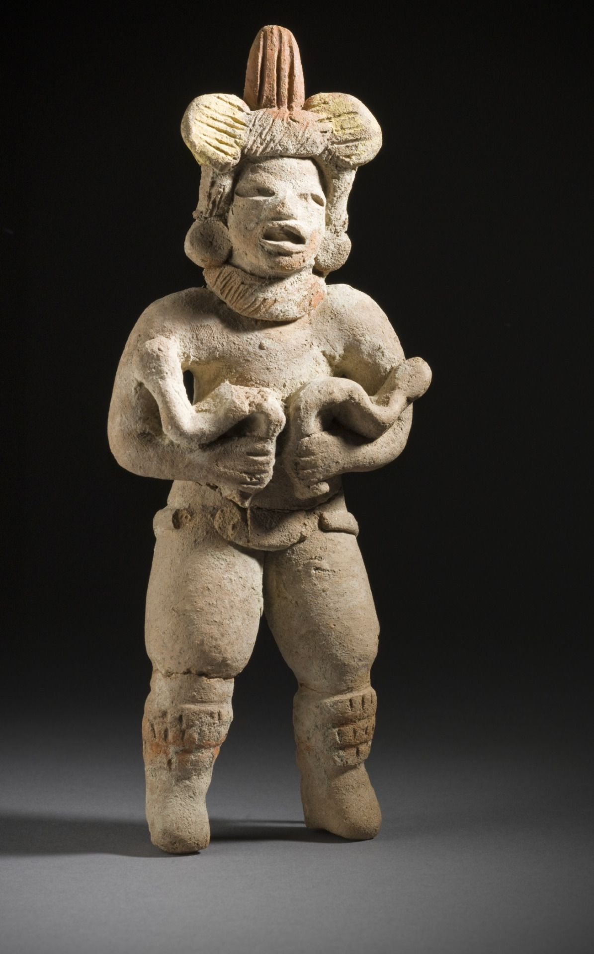 Dancer with SnakesMexico, Guerrero, Xochipala, 1000-500 B.C.Sculpture, Ceramic with postfire applied pigmentLACMA