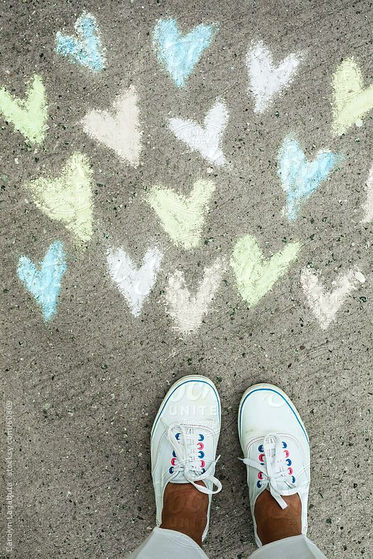 Chalk hearts and white tennies By catkleinAvailable to license exclusively at Stocksy