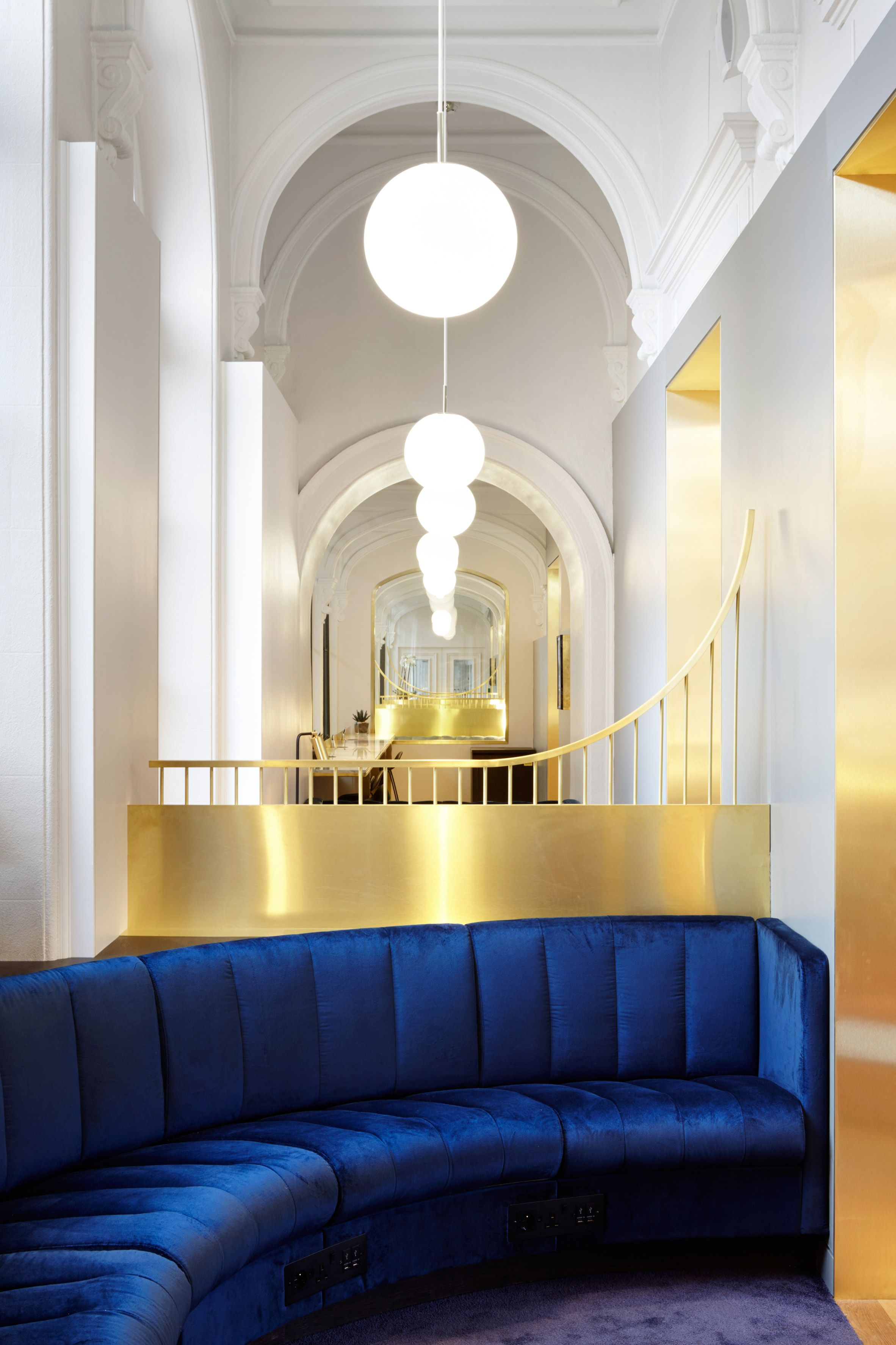 Softroom has designed a eurostar lounge for business class passengers in paris gare du nord featuring a circular cocktail bar and plush upholstery