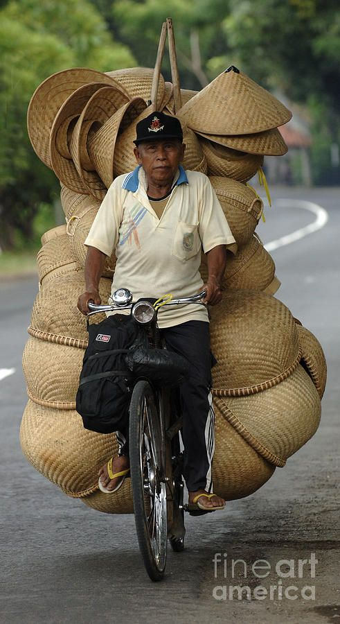 A local businessman peddles his goods in Bali, Indonesia....or should that be pedals his goods?