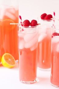 1 large bottle of Moscato or Riesling,   1 can of Raspberry Lemonade Concentrate, Splash pf Sprite and Crushed Raspberries