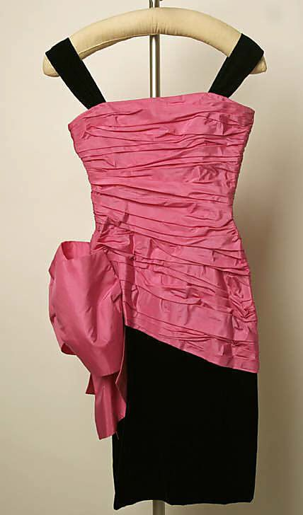 Black silk velvet and pink silk taffeta cocktail dress by Yves Saint Laurent, French, fall/winter 1983-84.