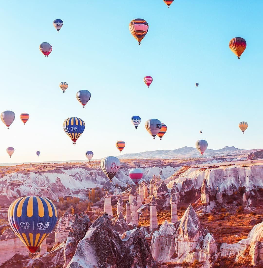Hot air balloons flood the sky over Turkey's Cappadocia