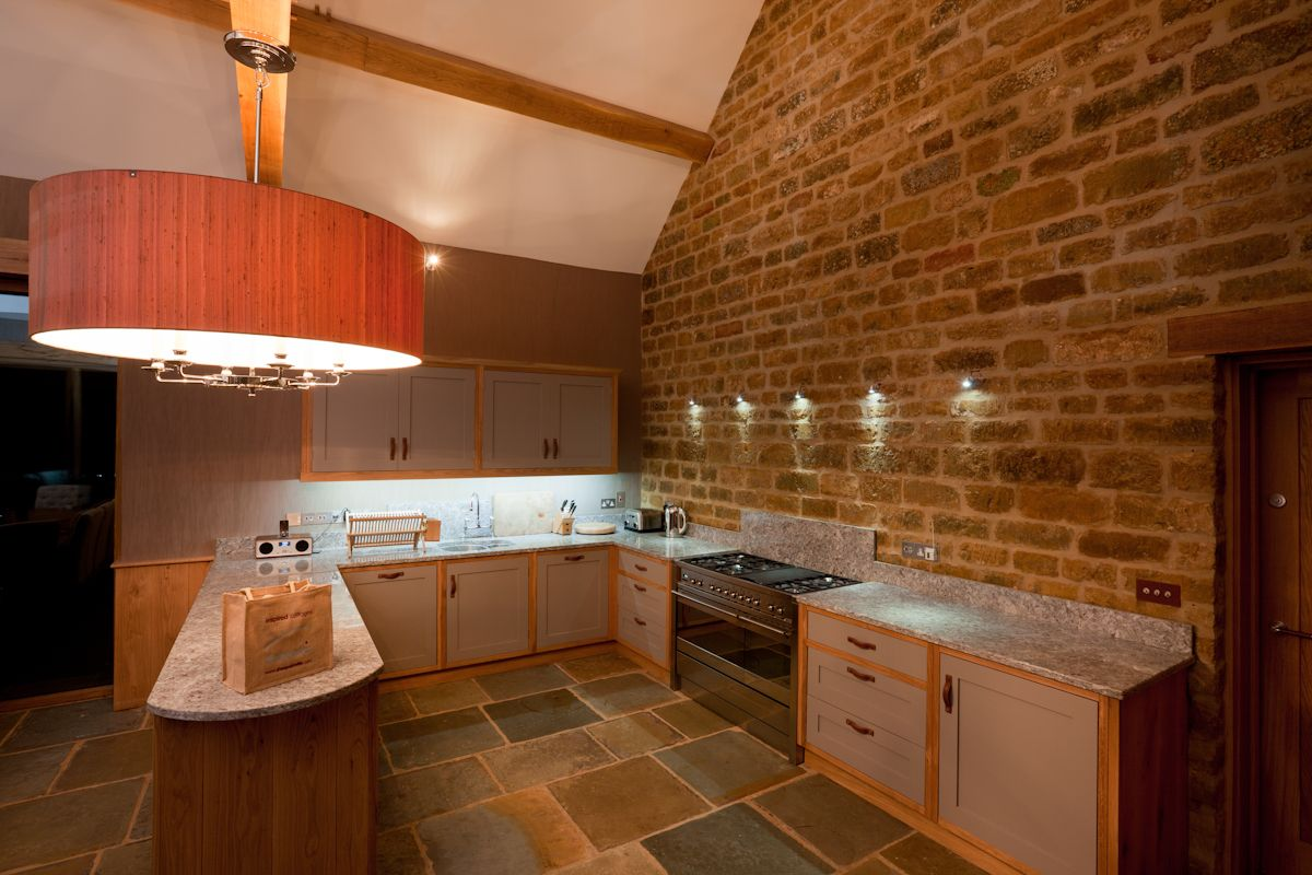 Spacious fully equipped kitchen at Chescombe Lodge where you can impress your party with your culinary skills. The kitchen is hand made and has two ovens, a large range gas hob, dishwasher, fridge and freezer.