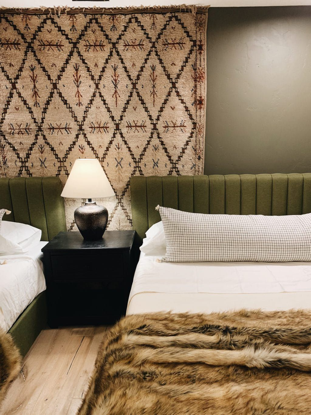 The Easiest Way To Hang A Rug On A Wall Green Rug Bedroom Arranging Bedroom Furniture Living Room Inspo