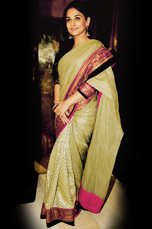 Cotton silk! :) Love the colours. And how stiff the saree is - the kind we don't really see people wear that often now a days. ---- For attending an Indian wedding