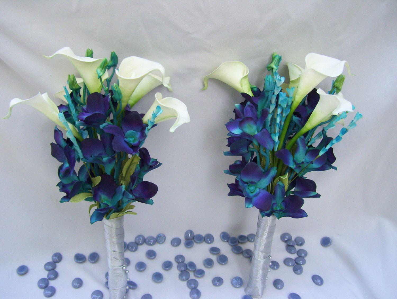 Lauraus bridemaid arm bouquet teal purple dendrobium orchids white