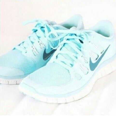 Light blue nike tekkies running shoes