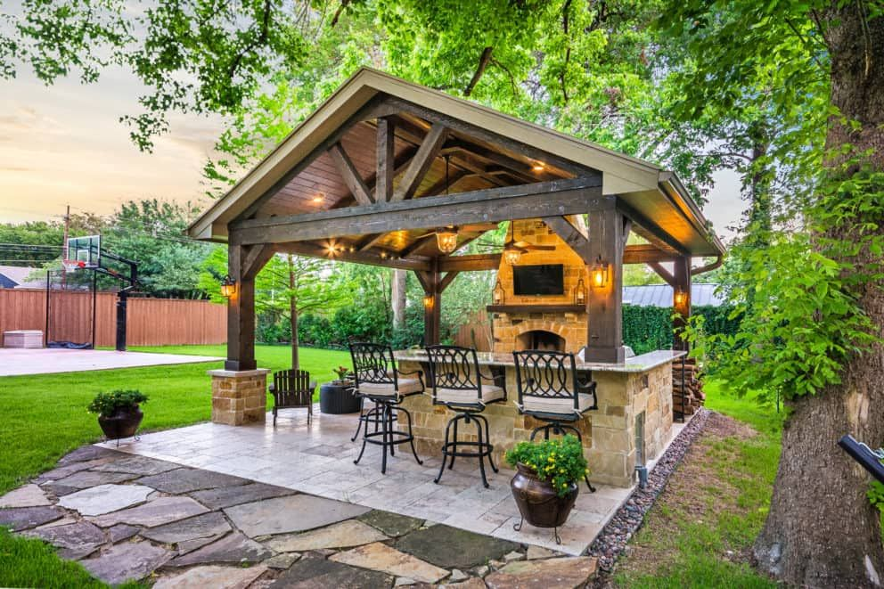 this freestanding covered patio with an outdoor kitchen and fireplace is the perfect retreat on outdoor kitchen gazebo ideas id=78299