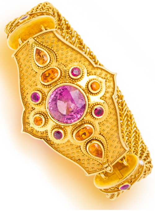 An eighteen karat gold and gem-set bracelet;   the mesh band centering a free-form granulated plaque, set with a circular-cut pink spinel, measuring approximately 12.60 x 12.50mm., within a vari-cut spessertite garnet and ruby surround; flanked by similarly designed links; with maker's mark for Kent Raible; gross weight approximately: 96.2 grams; approximately: length: 6in. Via Bonhams.