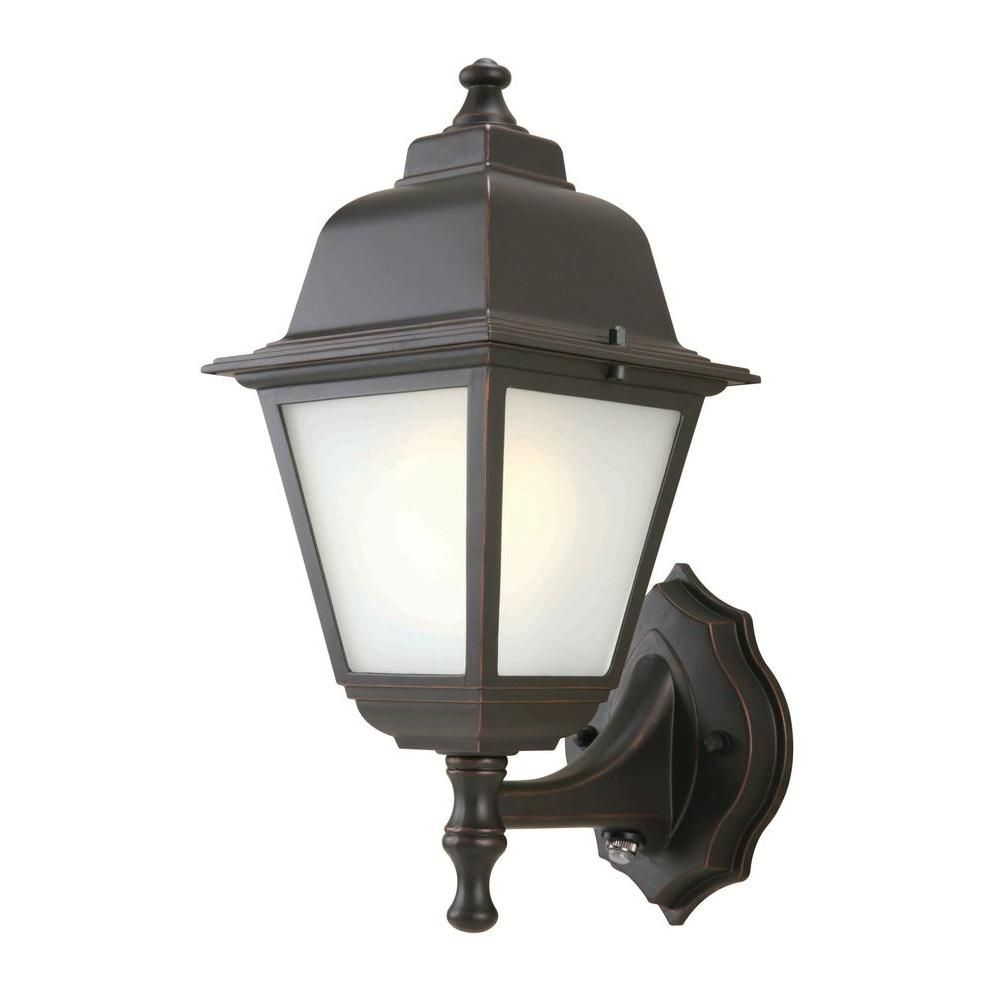 Light oilrubbed bronze outdoor dusktodawn wallmount lantern