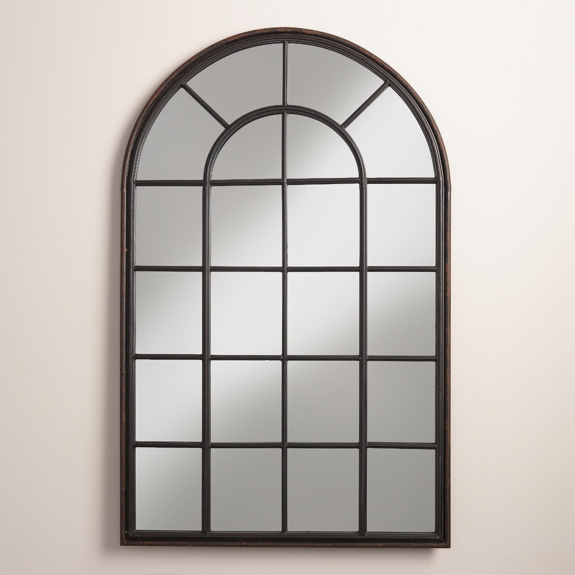 Our window-inspired iron mirror features a broad arch and ...