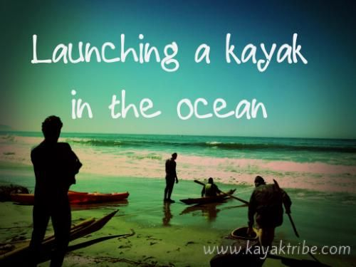 Launching a kayak in the ocean