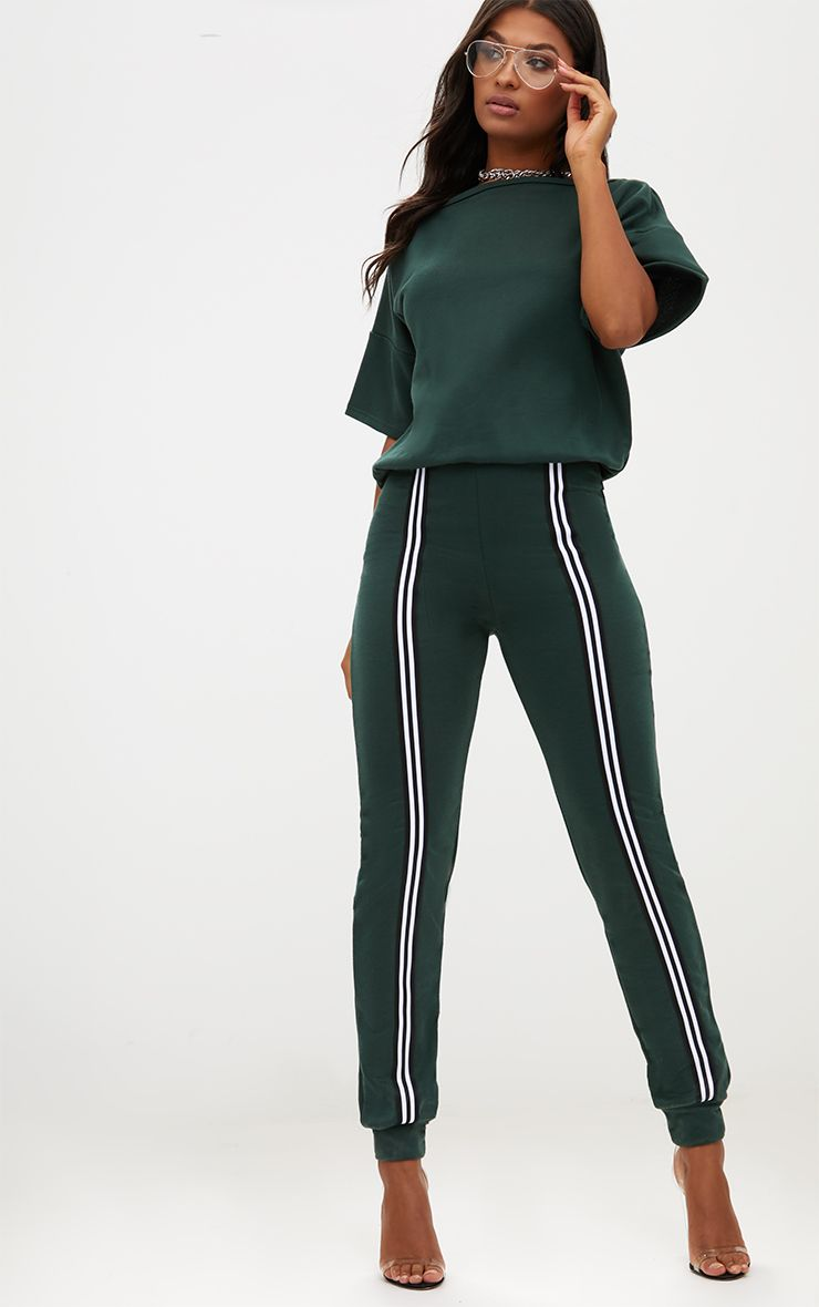 0da5a36fe638 Forest Green Loop Back Sports Stripe Jumpsuit. Shop the range of jumpsuits    playsuits today at PrettyLittleThing. Express delivery available. Order  now