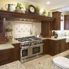 Image result for how to decorate on top of cabinets with vaulted ceiling #topkitchendesigns