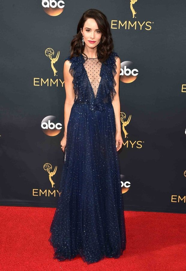 2016 Emmys: Abigail Spencer in a plunging navy-blue gown by Jenny Packham with a…