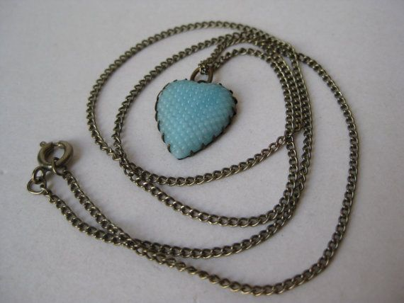Pretty little glass and brass heart necklace.