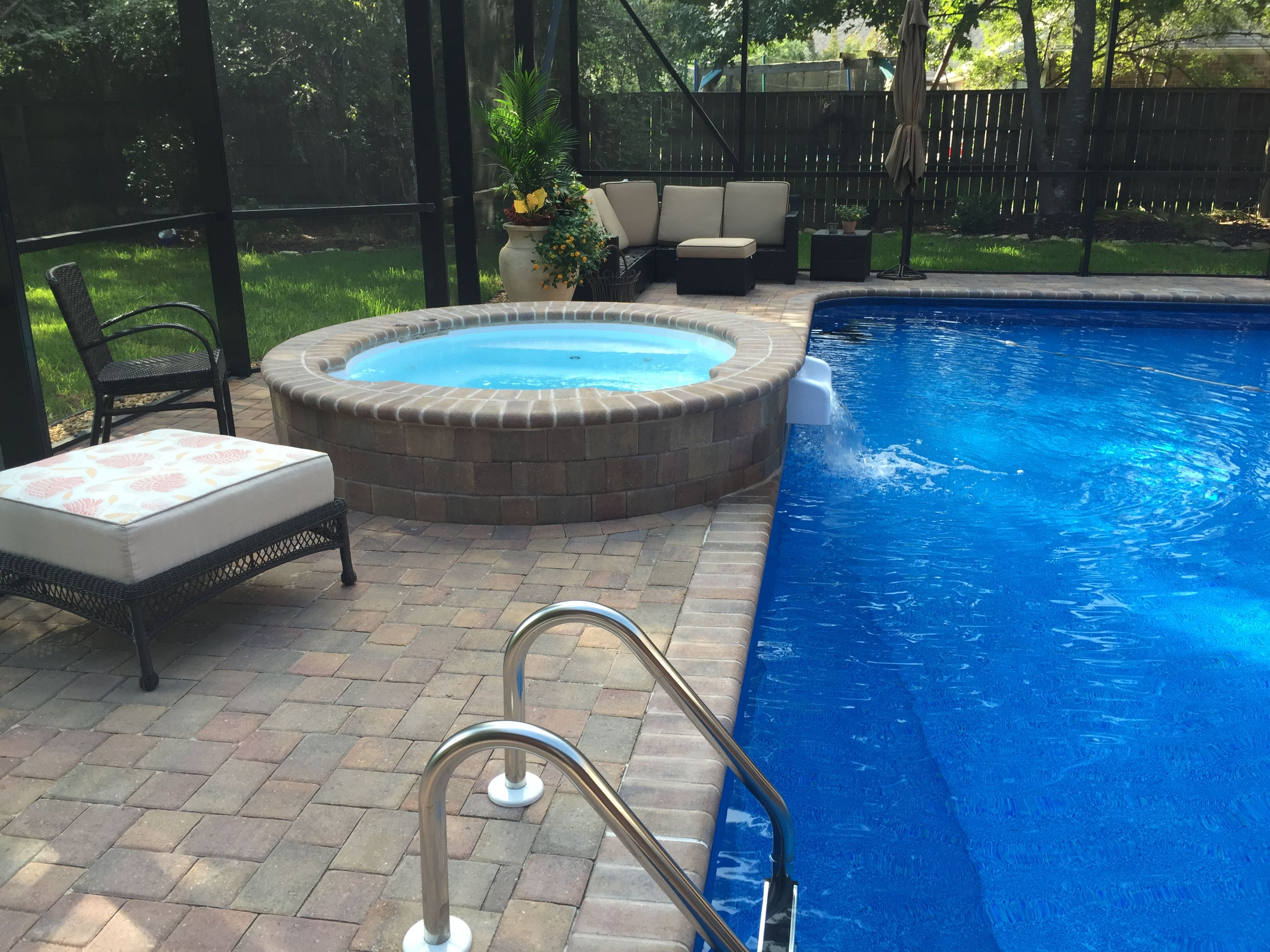 Spillover Spa With Brick Coping And Pavers With Latham