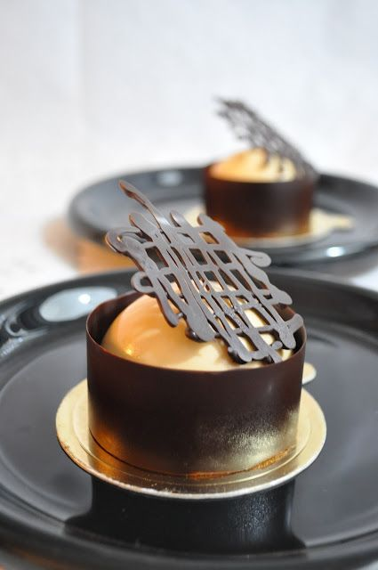 earl grey mousse, baileys milk chocolate mousse / butter génoise, wrapped & topped with dark chocolate decor