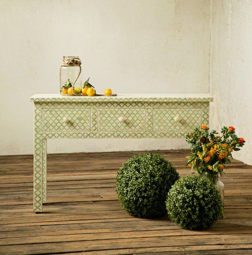 This beautiful mint colored, console table is hand crafted with camel bone inlay. Measures 48