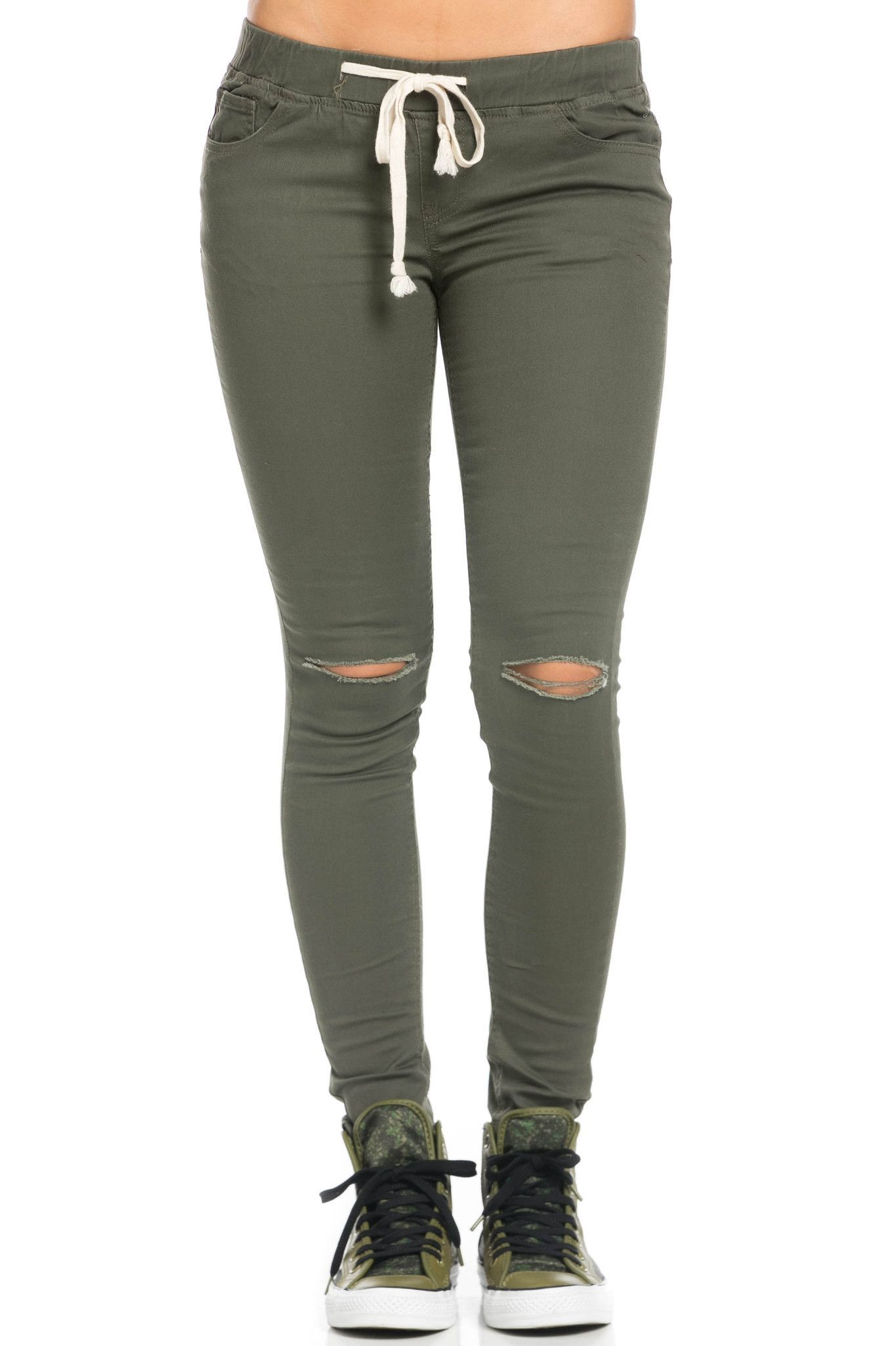 5b2cc4b50ad16 Distressed at the knee. A skinny, olive colored mid-rise jogger jean  featuring…