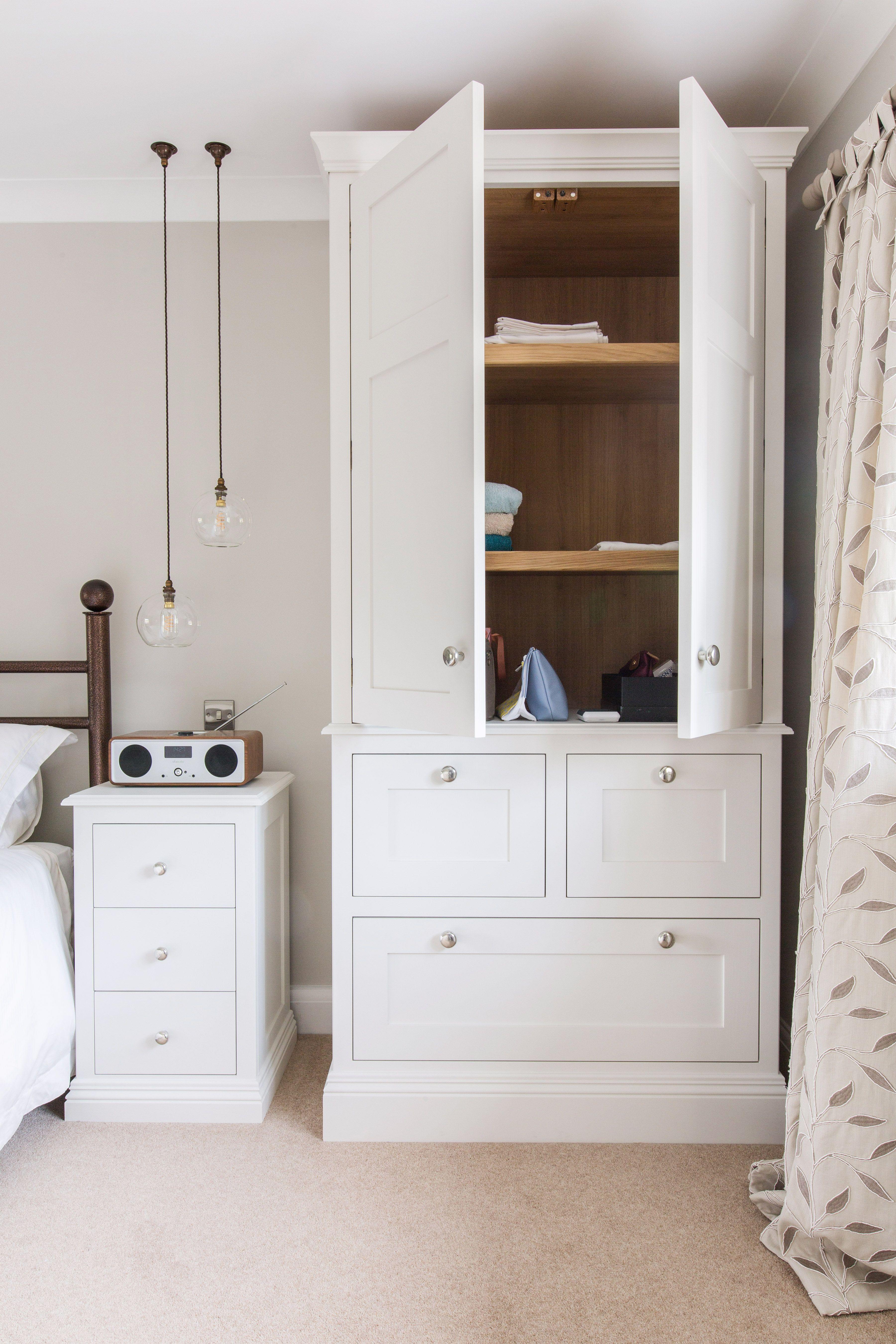 A peak inside a bespoke tall dresser unit, with oak shelves