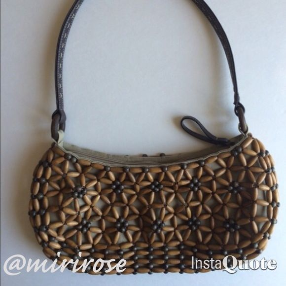 Nine West Wooden Bead Purse The perfect unique accessory to finish off that summer outfit. Wooden bead purse by Nine West. Nine West Bags