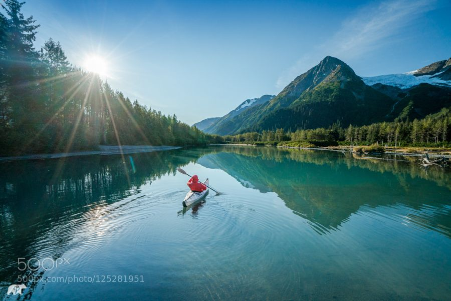 What better way to start the morning paddling through the slough at Explorer Glacier.   www.chrisburkard.com