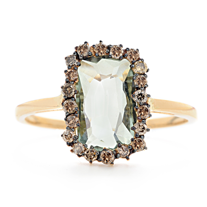 Envy green topaz is wrapped in a border of eclectic champagne diamonds in this uniquely crafted ring.  at Greenwich Jewelers, $995