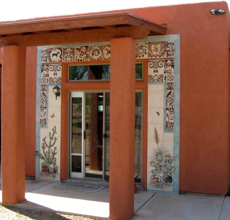 Desert Cactus Vegetation And Southwestern Indian Tribal Designs Tile Murals Frame The Entry To Tile Artist Ju Exterior Tiles Southwestern Design House Exterior