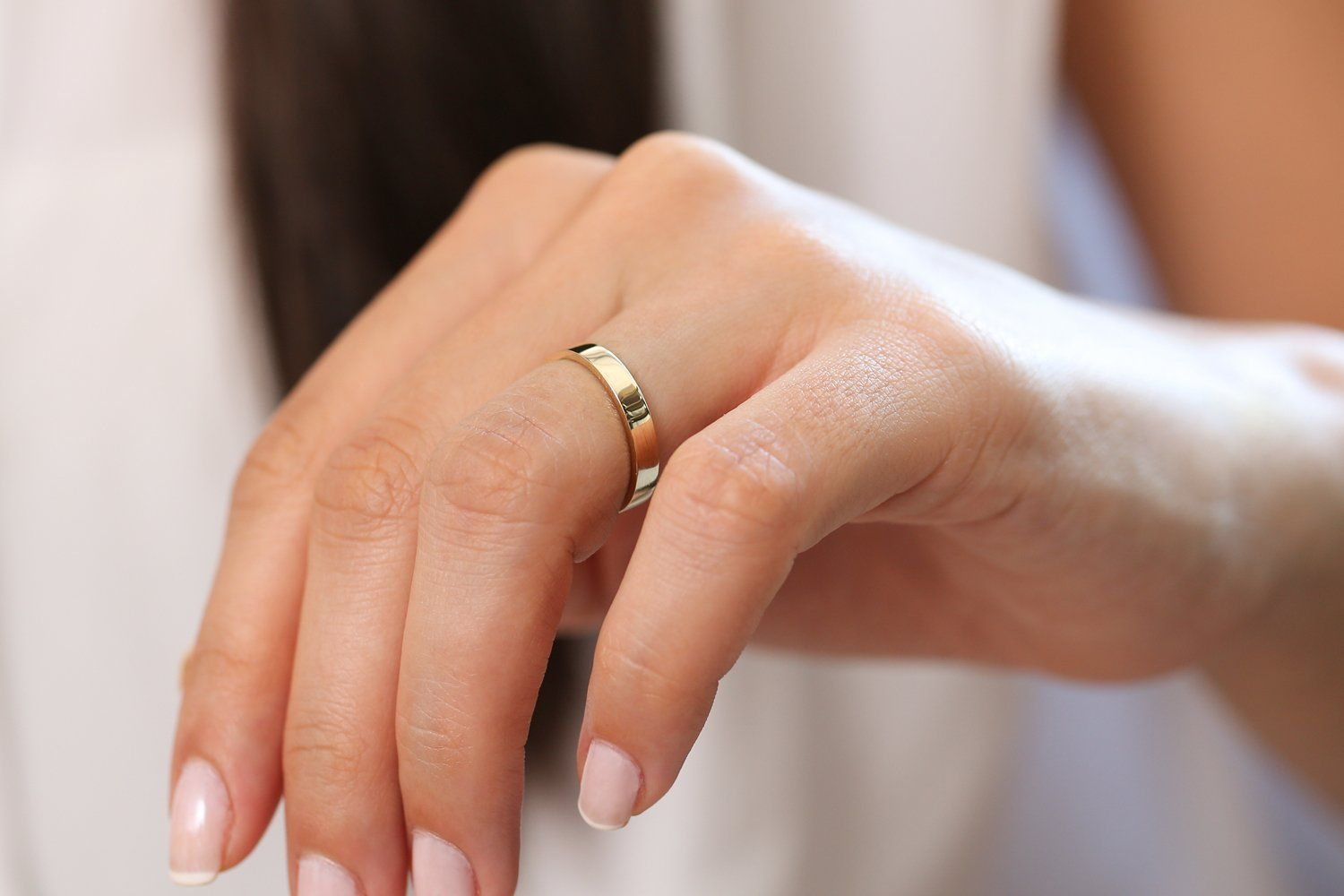 Item Details  Made to Order Gold KT: 14K Gold Color Option: Rose Gold, Yellow Gold, White Gold Measurement: Band 3.0mm Height: 1.3MM Size: 3 - 13 Ready to Ship in 7-10 Business Days  Description  This classic beautiful gold ring will look effortlessly chic paired with your engagement ring or even alone. The solid gold band is 3mm in width for a minimalist look that can be worn with anything. Handcrafted and made to order, this gold wedding band was made to last a lifetime.