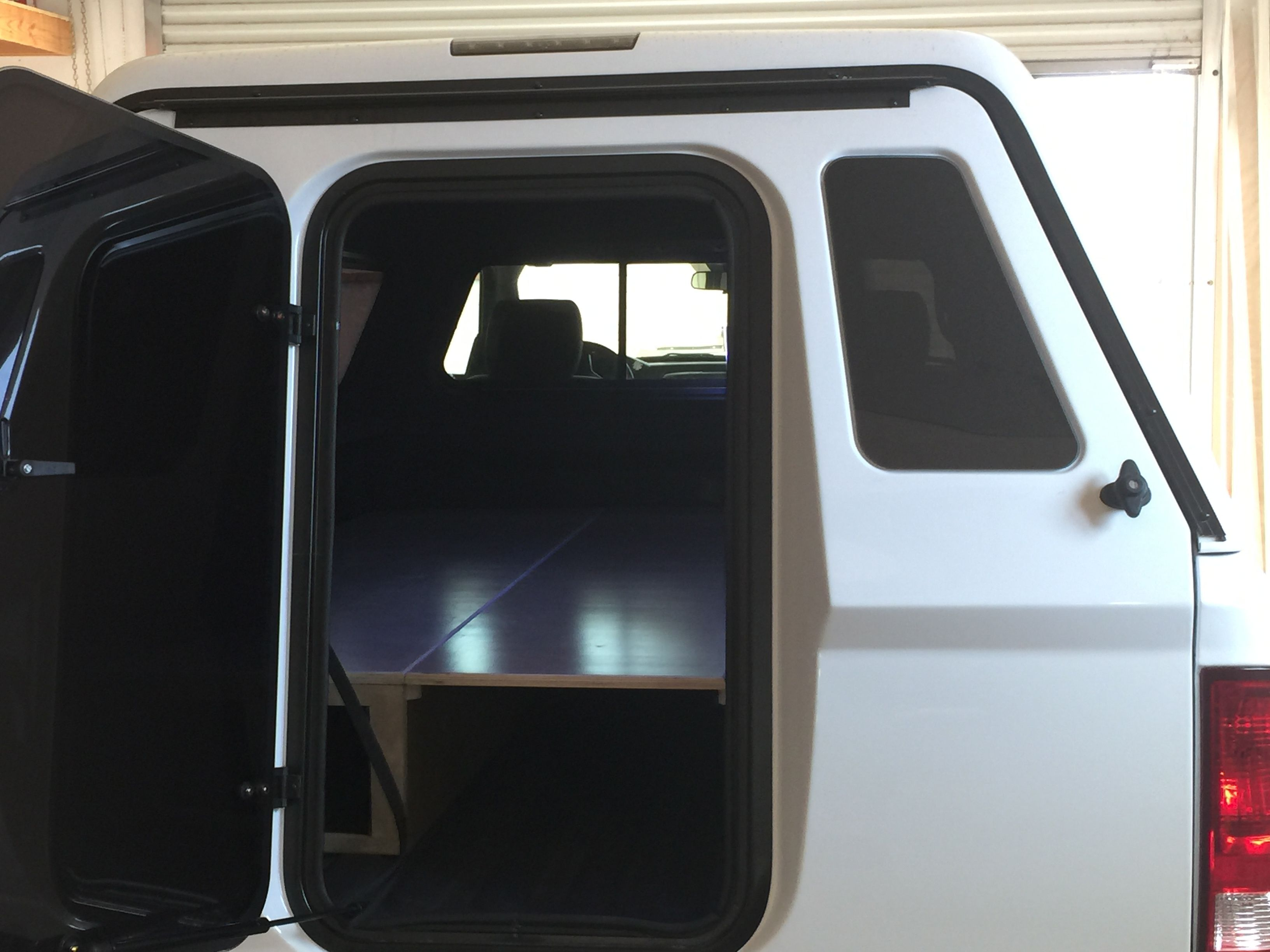 Rear Door Open View Camper Is An Are Mx Shell With Walk Through Door Truckcampershell Camping Campershellb Truck Camper Shells Camper Shells Pickup Camper