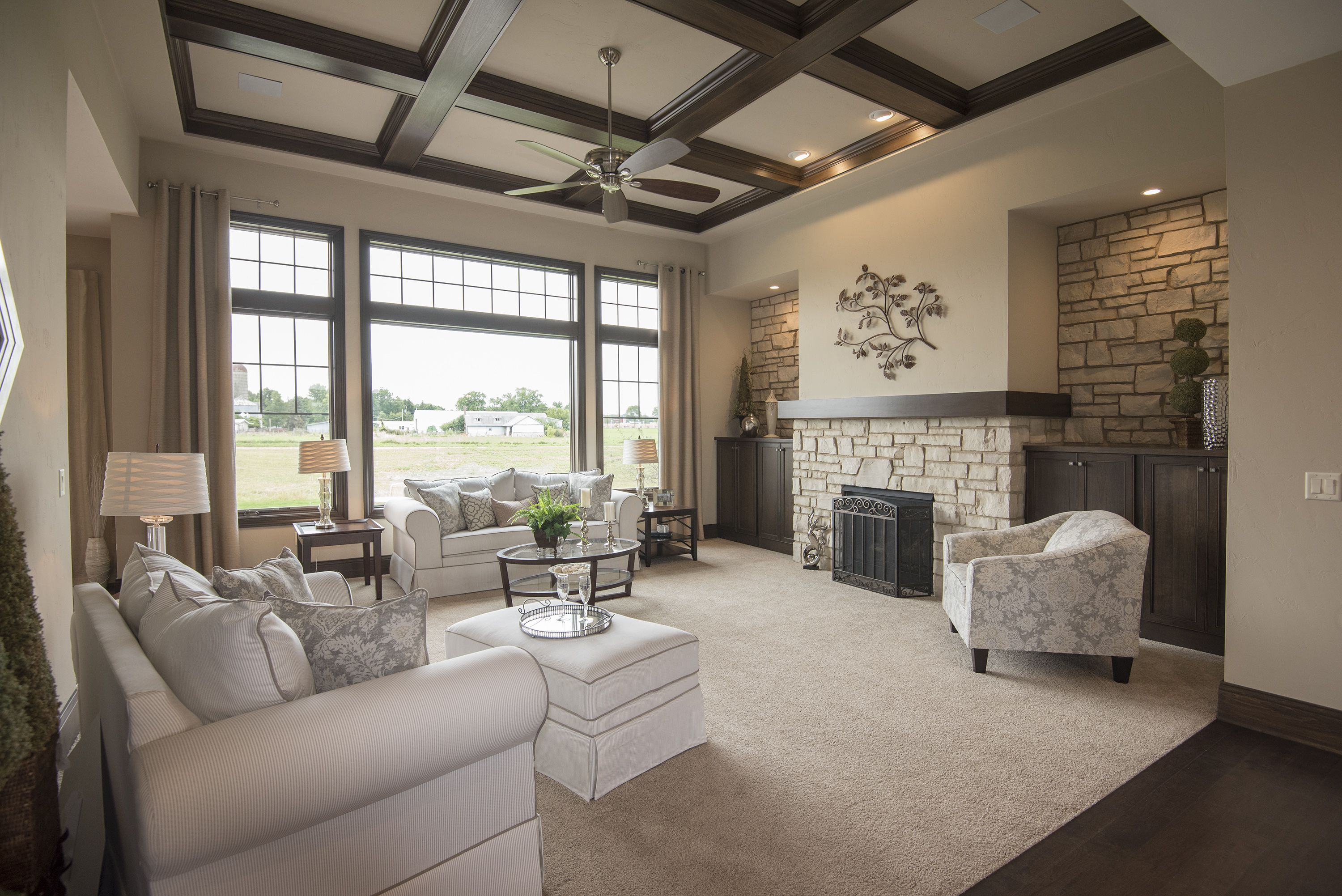 Great room with built-in cabinets surrounding fireplace ...