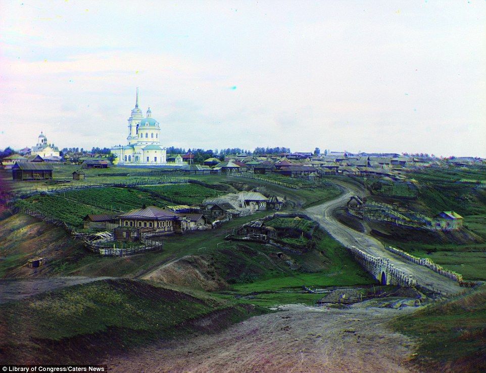 Rural life: This rather gloomy-looking shot shows the remote farming village of Kolchedan in Ural Mountains, taken in 1912
