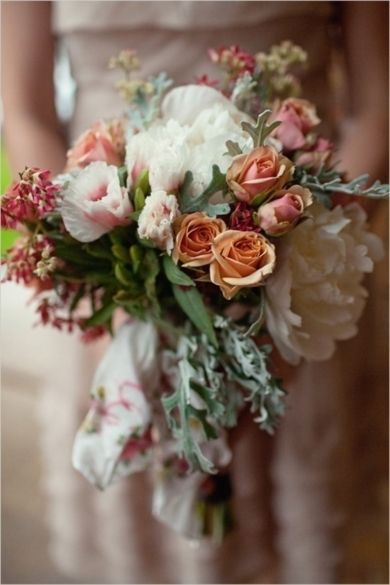 This country vintage chic bouquet is filled with waxy greenery and petite blooms in shades of ivory and antique pink. #Weddings #Boquet