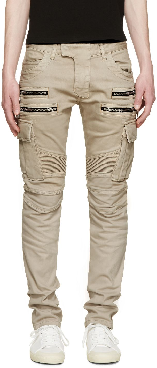 Slim-fit cotton cargo pants in beige. Five-pocket styling with zippered  welt pockets at front. Ribbed panelling at back waist and knees.
