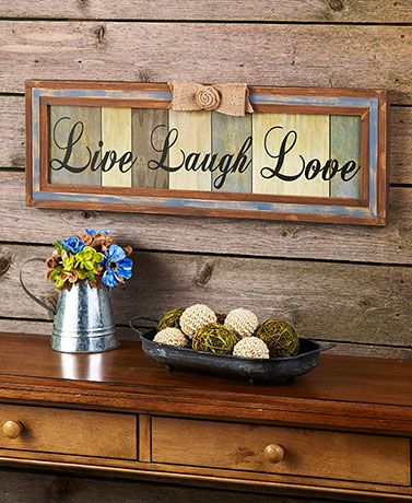 Make a bold statement on a wall of your home with this Rustic Live Laugh Love Plaque. The large plaque features a paneled wood design with a distressed finish.