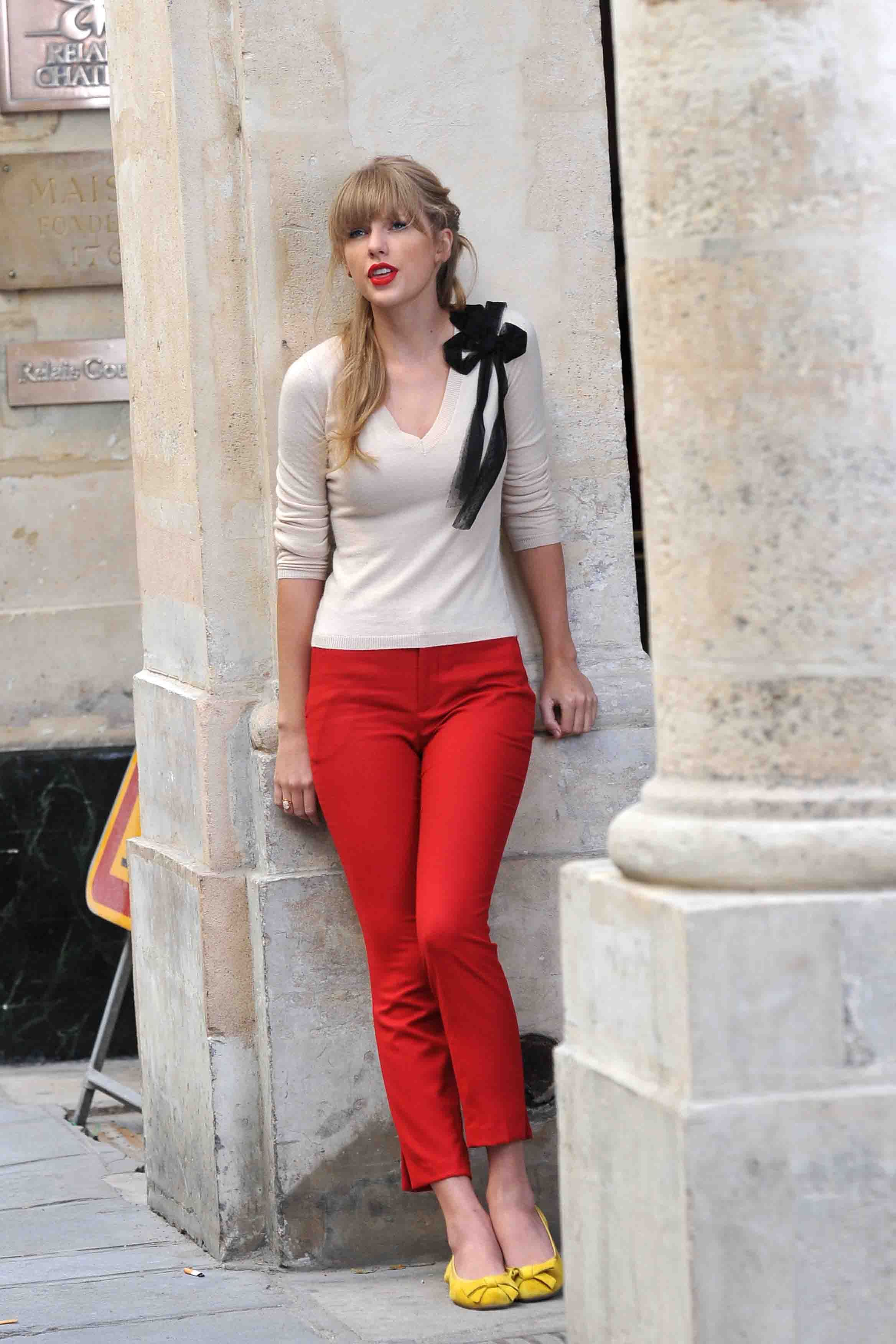 Taylor Swift 39 S Sweater With Bow Red Cropped Pants And Yellow Flats On Begin Again Music Video
