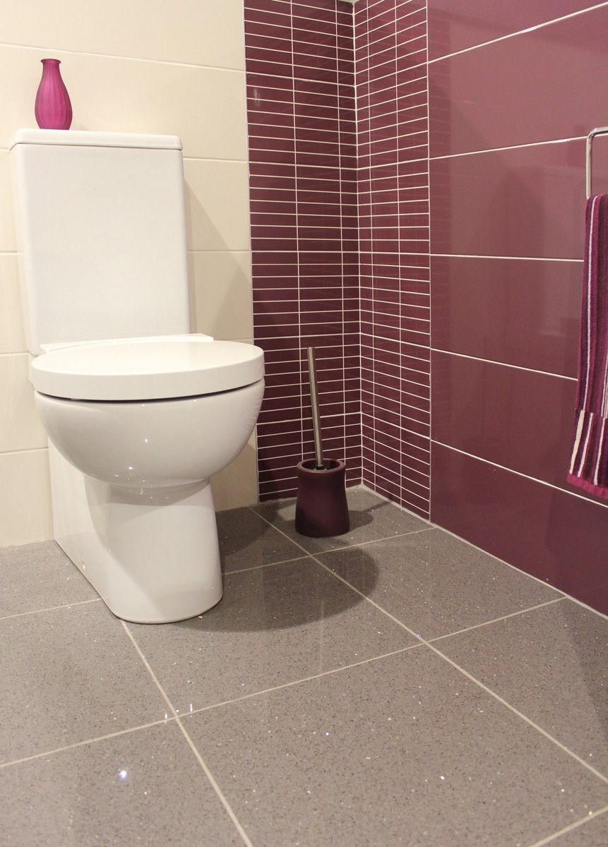 White Quartz Tiles Bathroom - This grey tile shown on the floor of this bathroom is a highly polished quartz tile
