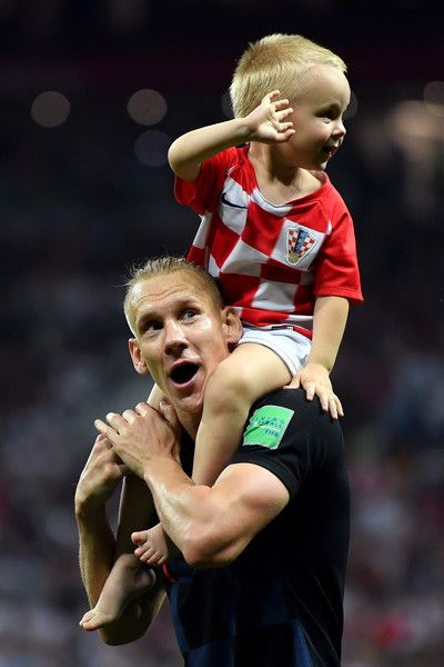 Domagoj Vida of Croatia celebrates with his son following his sides victory in the 2018 FIFA World Cup Russia Semi Final match between England and Croatia at Luzhniki Stadium on July 11, 2018 in Moscow, Russia.
