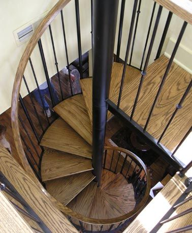 Best Dark Stained Red Oak Interior Spiral Stairs Custom 640 x 480